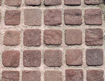 Small brown paves with pink joints Stock Photos
