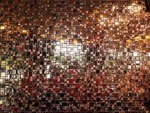 Small brown reflective sheet tiles. stock image