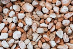 Small brown rocks background Royalty Free Stock Photos