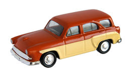 Small brown toy car. Small toy car with shallow depth of field isolated on white background stock photos