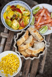 Small brunch on the terrace. Salad, corn and salmon for the brunch Royalty Free Stock Photo
