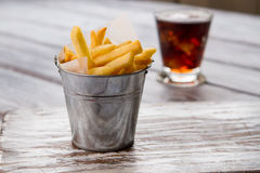 Small bucket with yellow fries. Stock Image