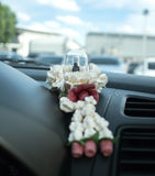 Small buddha amulet with garland on the car console Royalty Free Stock Photography