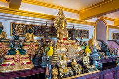 The small Buddha sculpture inside the temple of the Golden Mountain or Wat Saket. stock image