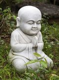 Small Buddha statue in a garden. Small Buddha statue staying in a garden stock photo