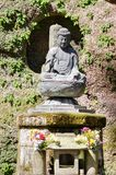 Small Buddha statue at Kamakura gardens. Japan stock image