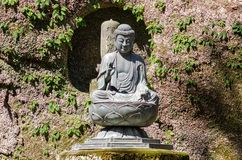 Small Buddha statue at Kamakura gardens. Japan stock photo
