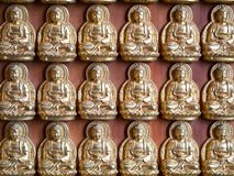 Small Buddha Statue in Rows Stock Photo