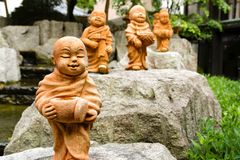 Small buddhas. Figures of Buddha from a garden in Kyoto, Japan Stock Photography