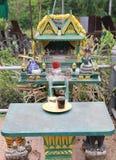 Small Buddhist Shrine with cobra snake statue. In Phuket,Thailand Royalty Free Stock Photography