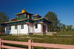 Small Buddhist temple. With white walls and a green roof stock photos