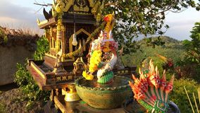 Small Buddist House of Spirits with Alms to the Gods. Phuket, Thailand. HD slowmotion. stock video