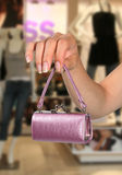 Small Budget. A woman holding a small purse - conceptual image for a small budget Royalty Free Stock Photos