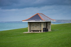 Small building on cliff  over Atlantic Royalty Free Stock Photo