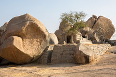 A small building among the rocks. A small stone building with steps is located among the rocks Royalty Free Stock Image