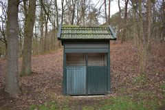 Small building in a petting zoo. A small building of unknown purpose in a Dutch petting zoo royalty free stock photos