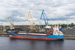 Small bulk carrier ship loading coal Riga Stock Image