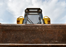 Small bulldozer. Does the work Royalty Free Stock Photography