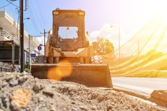 Small bulldozer. Sunny Royalty Free Stock Images