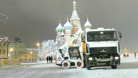Small bulldozer loads 1st wet snow to trucks on Red Square stock video footage