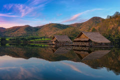 Small bungalow made of bamboo floating at lake. Small bungalow made of bamboo floating in lake at Khao wong resevoir in morning Royalty Free Stock Photography
