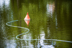 Small buoy on the water Stock Images