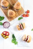 Party beef burgers sliders share. Small burger sliders for share mayo onion board sharing platter party food Royalty Free Stock Photos