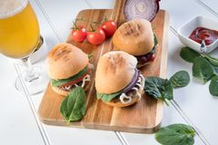Party beef burgers sliders share. Small burger sliders for share mayo onion board sharing platter party food Royalty Free Stock Photo