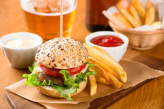 Small burger snack with fries and beer Stock Photo