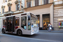 Small bus goes on streets of Rome, Italy Stock Photography