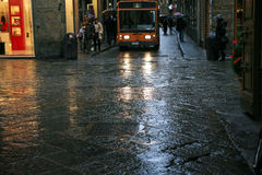 Small bus in narrow streets of medieval town Royalty Free Stock Image