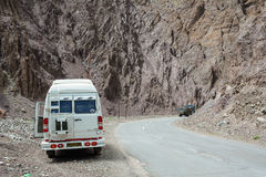 A small bus parking on the Nubra Road in Ladakh, India Royalty Free Stock Photo