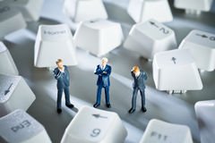 Small business. Business figurines placed with keys from a computer keyboard royalty free stock photography