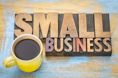 Small business banner in letterpress wood type. Small business banner in vintage letterpress wood type blocks stained by color inks with a cup of coffee royalty free stock photos
