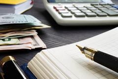 Small business bookkeeping and investment. Calculator and money. Small business bookkeeping and investment concept. Calculator and money stock image