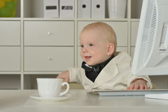 Small  business boy and computer Stock Photos