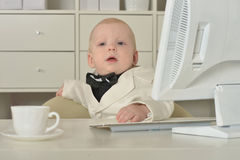 Small  business boy and computer Royalty Free Stock Images