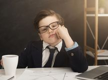 Small business boy got bored in office stock image
