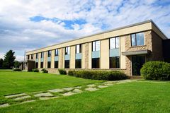 Small business building or school perspective shot. Small office or business building or college school perspective shot with sky and grass Royalty Free Stock Photos