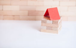 Small business building with wood cube. Small business building with small wood cube Royalty Free Stock Photos