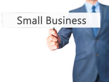 Small Business - Businessman hand holding sign royalty free stock photo