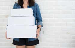 Small business concept. Woman holding cardboard boxes royalty free stock photo