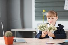 Small business considers money received for a bargain Royalty Free Stock Image