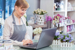 Small business entrepreneur florist in her store royalty free stock photo
