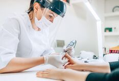Free Small Business Existence At COVID-19 Lockdown Concept. Professional Manicure Master In Transparent Safety Face Shield Using Stock Images - 183790274