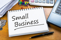 Small Business. Handwriting of Small Business on working table Royalty Free Stock Photos