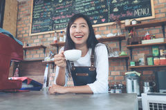 Small business: Happy owner of a cafe. Young startup owner small stock photography