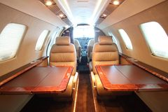 Small business jet cabin - front, both tables Stock Photography