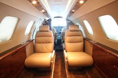 Small business jet cabin - front, cockpit open Royalty Free Stock Photography