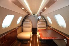 Small business jet cabin rear left table Stock Photography